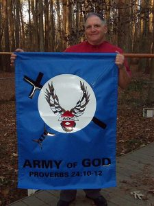 450px-Donald_Spitz_holds_Army_of_God_Banner