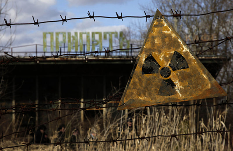nuclear bomb effects A radioactive sign hangs on barbed wire outside a café in Pripyat.