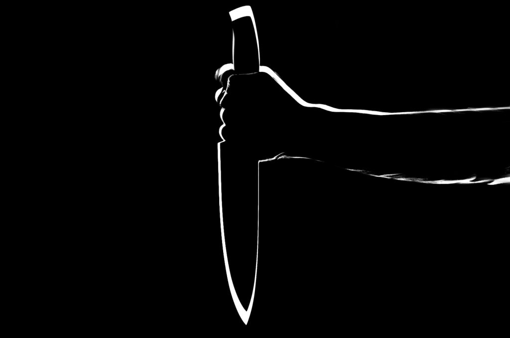 silhouette-of-hand-with-knife