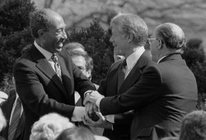 Sadat_Carter_Begin_handshake_(cropped)_-_USNWR